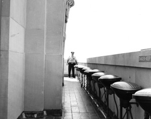 Observation deck with police officer standing at end